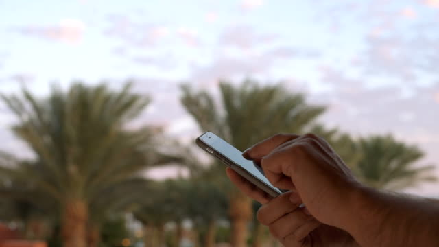 Man using smart phone. video