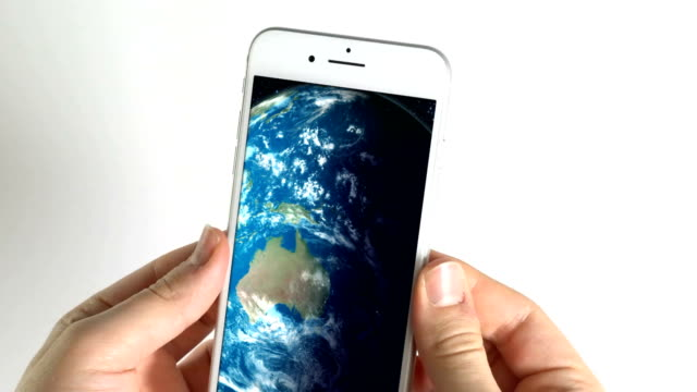 Man using smartphone and Earth Globe in screen on white background