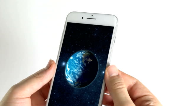 Man using smartphone and Earth in the screen on white background