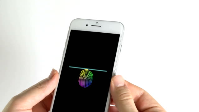 Man using smartphone and the colorful finger print in screen scanning finger on black background