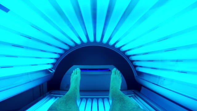 Man using solarium tanning bed A point of view shot of a man using a tanning bed at a solarium salon. sunbathing stock videos & royalty-free footage
