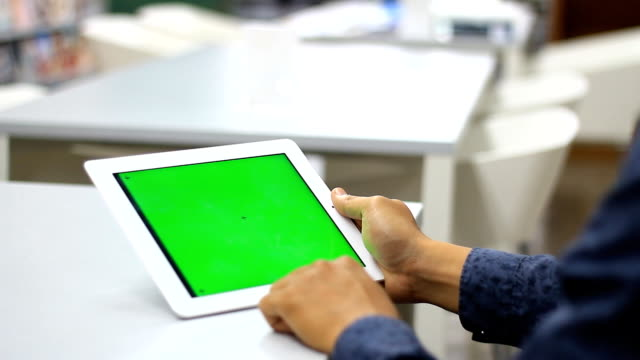 Man using Tablet in the library video