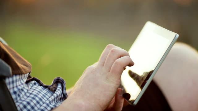 Man Using Tablet Outdoor video