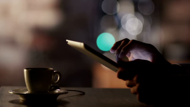 Man Using Tablet PC and Drinking Coffee in Cafe. video