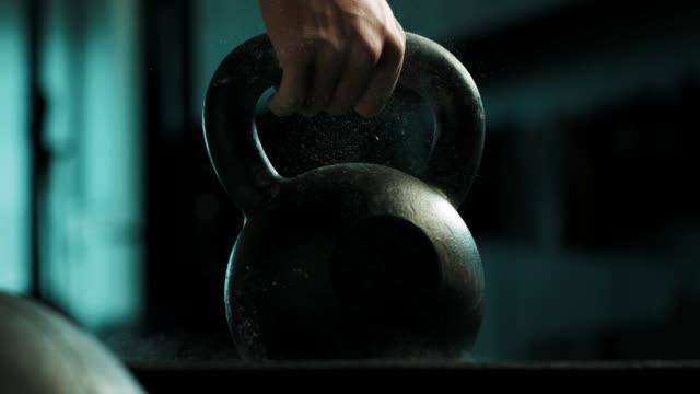 Man using the kettlebell Man using the kettlebell in gym. Crossfitt training. cross training stock videos & royalty-free footage