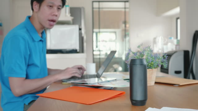 Man using voice to command home appliance and equipment Man using voice to command home appliance and equipment . For smarthome and home automation concept bluetooth stock videos & royalty-free footage