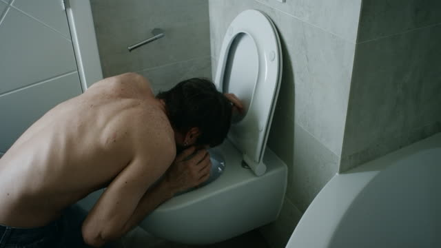 Man Vomiting In Bathroom video
