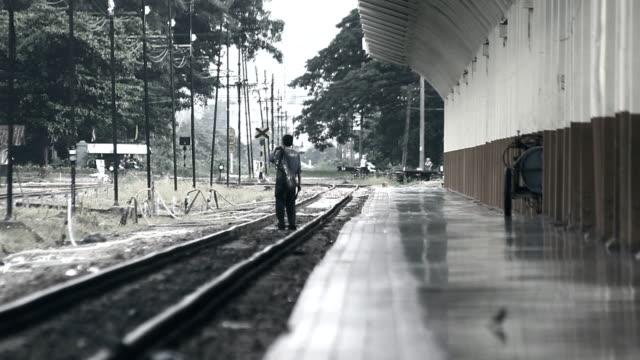man walk on railway video