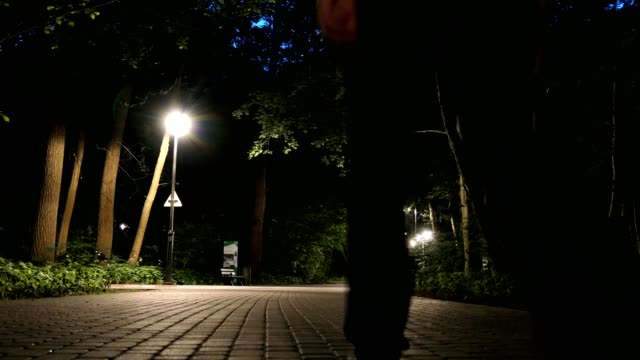 Man Walking Alone On Dark Park Alley video