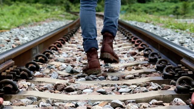 Man walking along the railroad in rural. video