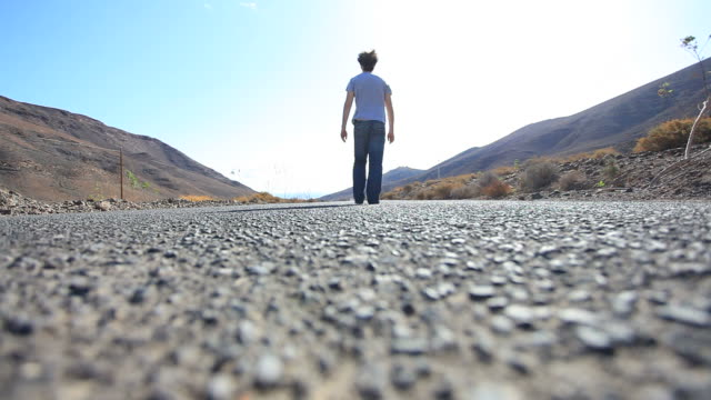 Man Walking Barefoot Along Empty Road at Morning, Freedom video