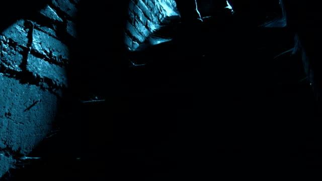 man walking downstairs in moonlight at night - basement stock videos & royalty-free footage