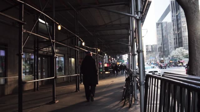 Man Walking Downtown NYC Golden Hour