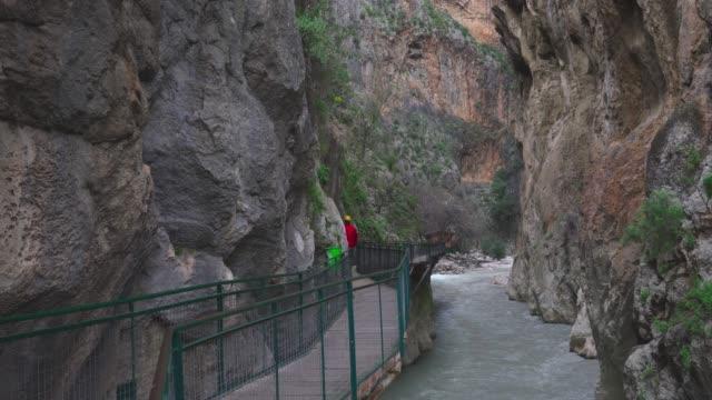 man walking in canyon