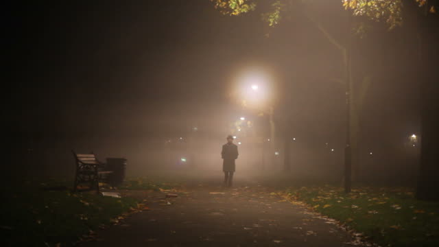 man walking in the mist man walking in the mist park bench stock videos & royalty-free footage