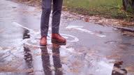 istock man walking on a wet bike road 1285319874