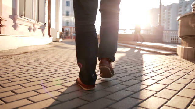 man walking on sidewalk. closeup foot video