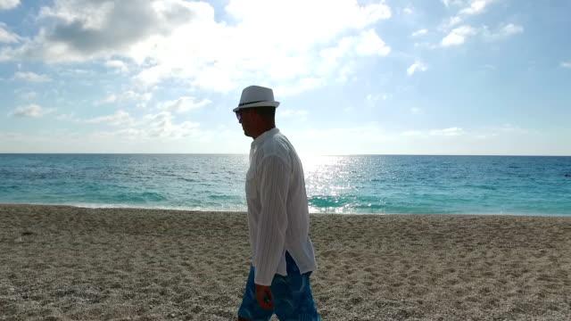 Man Walking on the Beach video