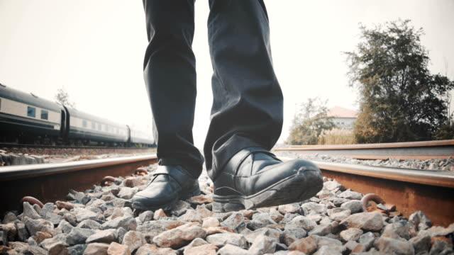 Man walking on the railroad video