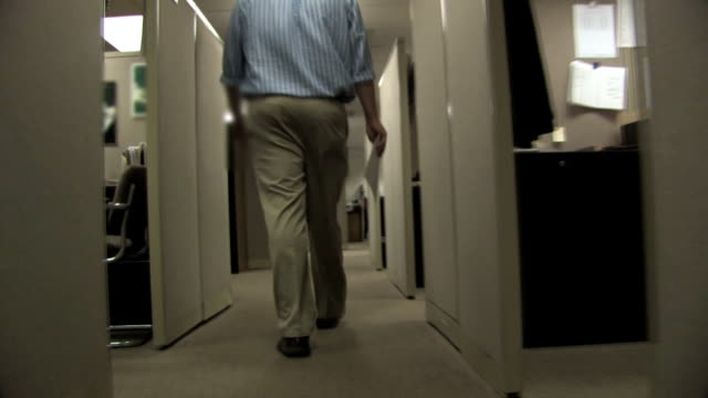 Man Walking through Cubicles Time lapse of a businessman walking through rows of cubicles and down an office hallway office cubicle stock videos & royalty-free footage