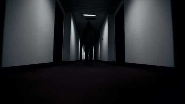Man walking through hotel corridor video