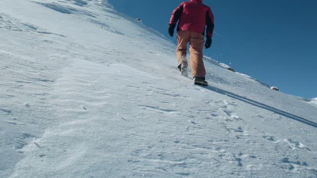 Man walking uphill on a glacier. video