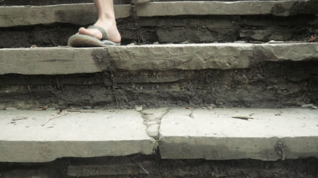 Man Walks Down Natural Stone Steps on a Hiking Path video
