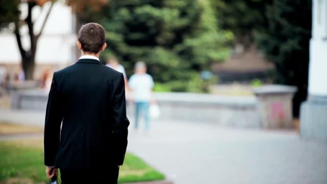 A man walks down the street, rear view. video
