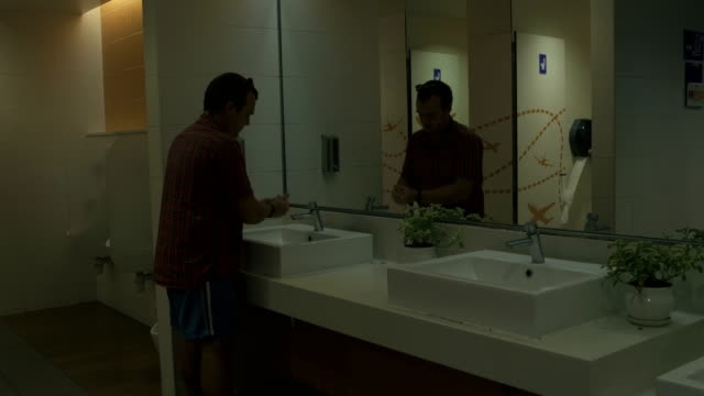 A man washes hands with soap at tualee airport video