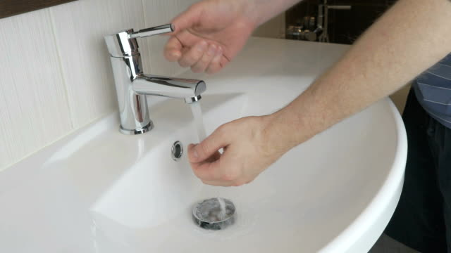 Man washing hands in the bathroom video