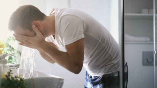 Man washing his face in the morning. video