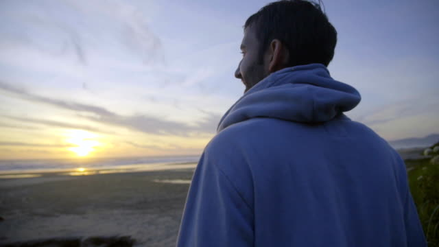 Man watches beautiful sunset video