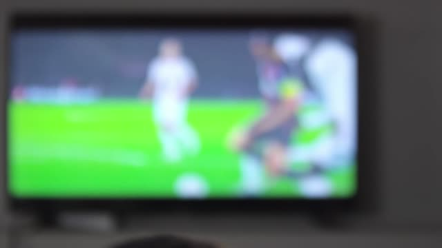 Man Watching Soccer Game on TV Screen video