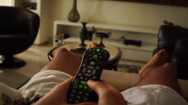 POV of Man Watching Tv in Sofa POV of Man Watching Tv in Sofa changing channels stock videos & royalty-free footage