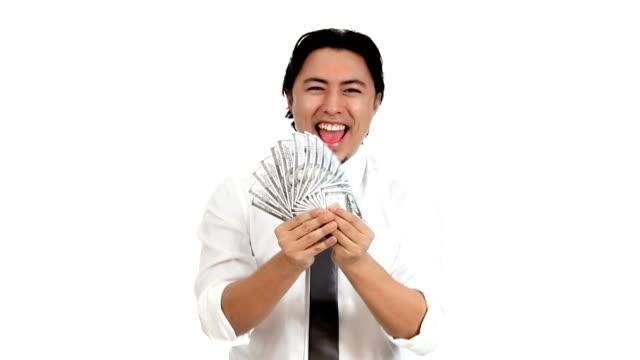 Man waving 100 dollar bills in front of him video