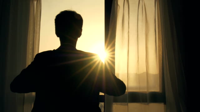 Man wear his jacket in the morning Man wear his jacket in the morning sunrise dawn stock videos & royalty-free footage