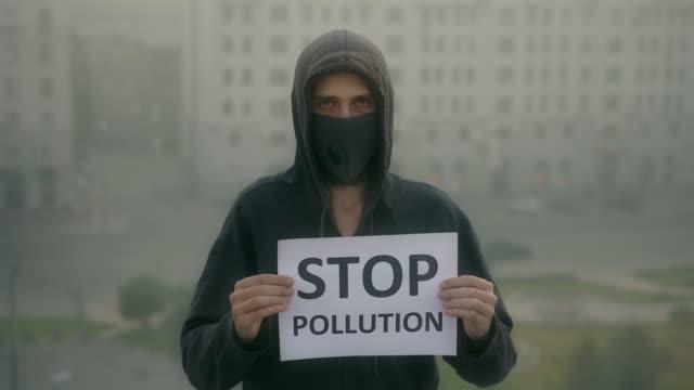Man wear respiratory mask. Stop air pollution. City traffic smog. Rrespirator video