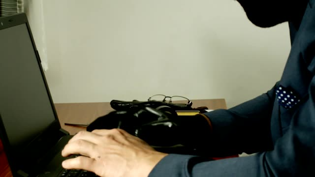 A Man Wearing A Burglar Mask Performing Fraud Online. video