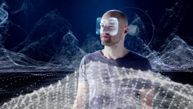 Man wearing holographic virtual reality glasses. Exploring virtual reality video