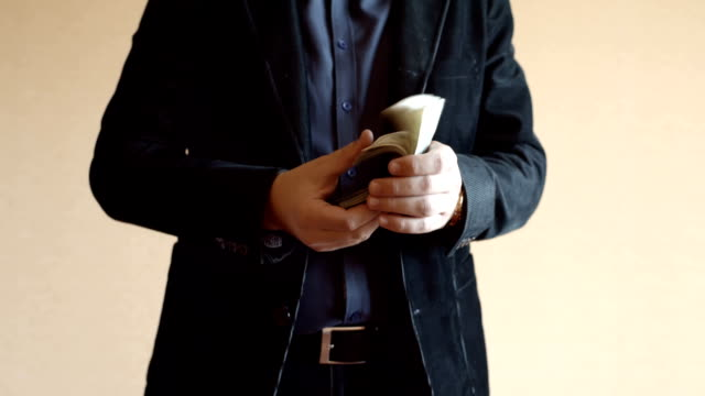Man Wearing Suit And Money In His Hands video