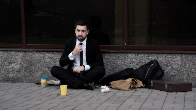 Man wearing suit begging in street video