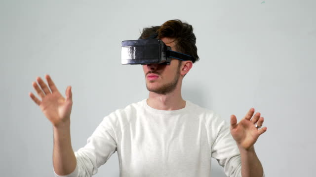 Man wearing virtual reality glasses and making specific gestures video