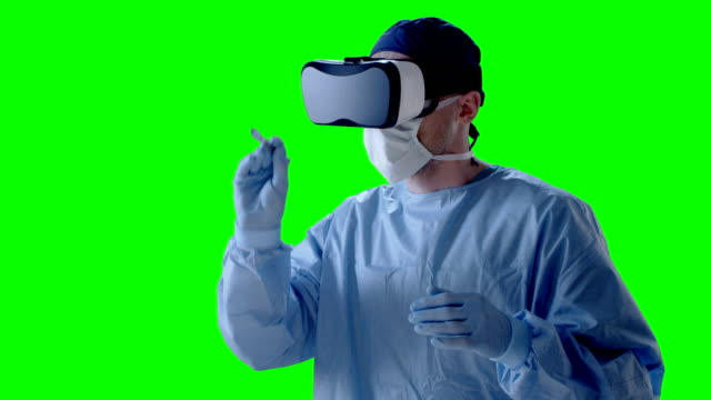 Man wearing virtual reality glasses during surgery video