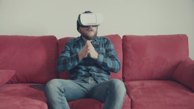Man wearing virtual reality headset at home video