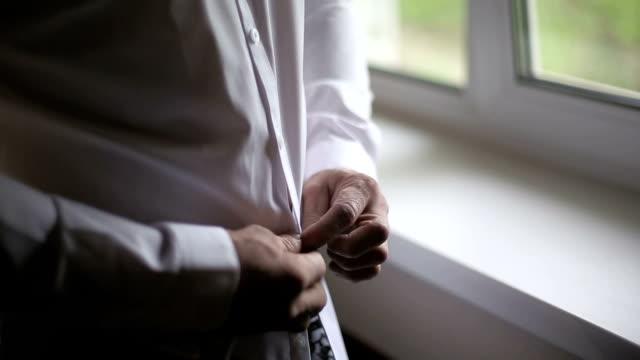 Man wearing white shirt in the morning Man wearing white shirt in the morning button down shirt stock videos & royalty-free footage