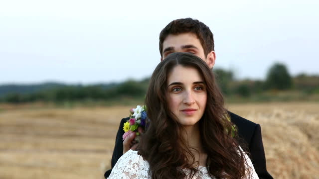 Man wears a wreath of flowers on head his girl. video