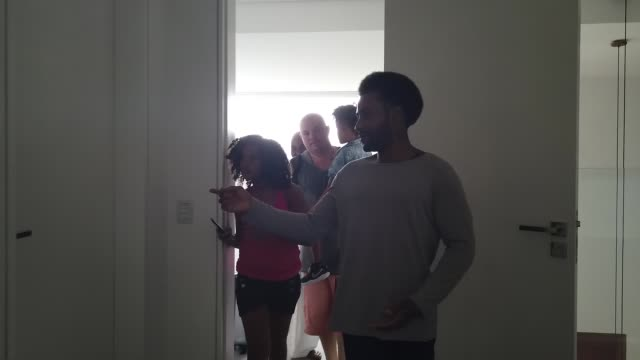 Man welcoming famly to rented house
