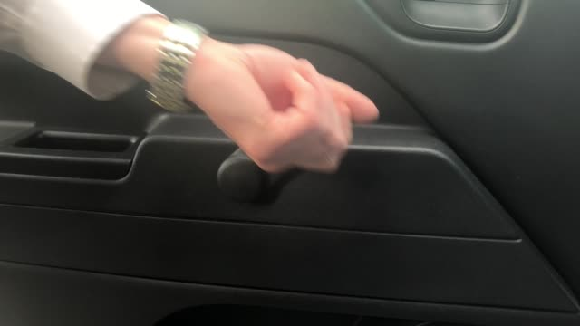 Man Winds Up and Down a Manual Car Window A man winds up and down a manual car window. crank mechanism stock videos & royalty-free footage