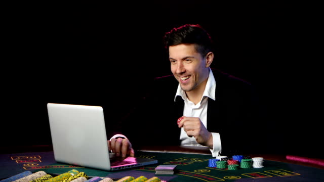 Man wins the game online poker. Close up video