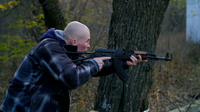 Man with a gun in a forest video
